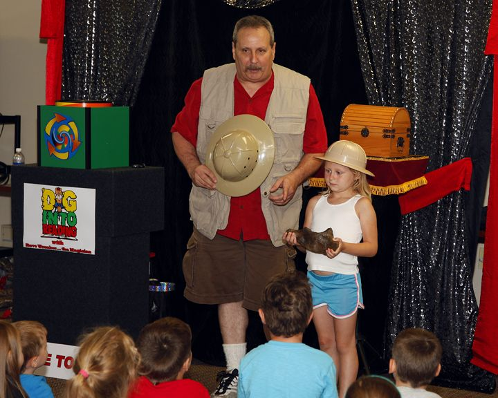 Wednesday, July 16 -  Dig Into Reading Magic Show Steve Wronker. A comedy magic show celebrating dinosaurs and reading, with a variety of one of a kind tricks and even a real dinosaur fossil.Spectacular, Kind Tricks, Comedy Magic, Reading Magic, July 7 Auguste, Dinosaurs Fossils, Celebrities Dinosaurs, Families Series, Real Dinosaurs