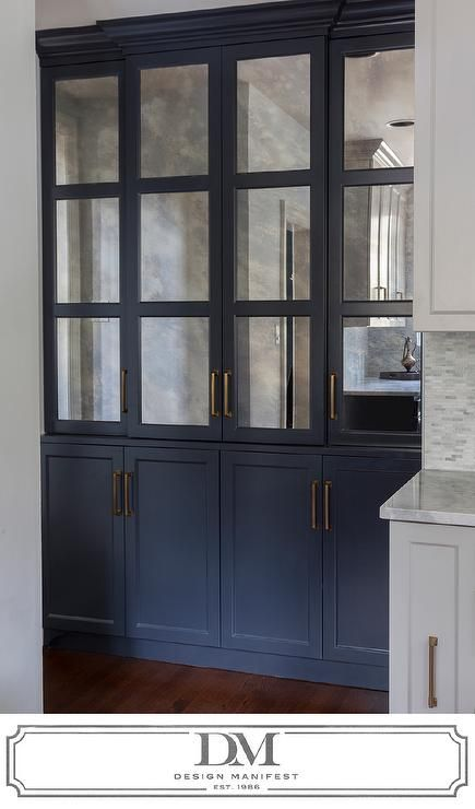 Kitchen with dark grey cabinets painted Benjamin Moore Raccoon Fur accented with antiqued mirrored cabinet doors.