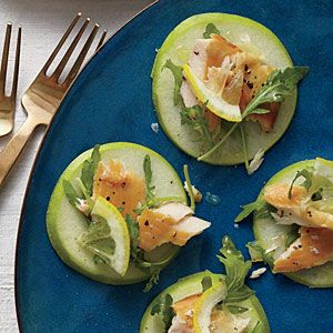 Smoked Trout, Arugula, and Granny Smith Stacks Recipe. Who would've thought to use an apple slice as a base for an appetizer? Try cheese or walnut spread