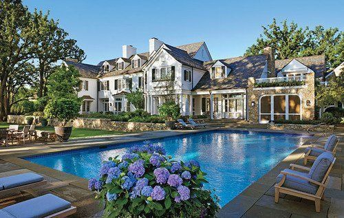 The backyard pool (and a beautiful white house with black shutters)