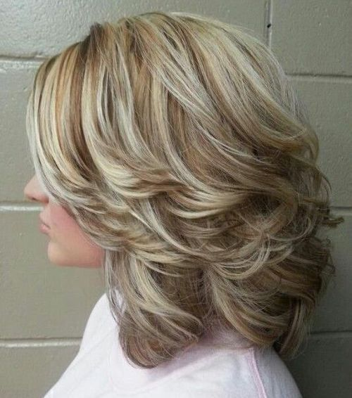Medium Curly Hairstyles With Highlights And Back-Swept Layers