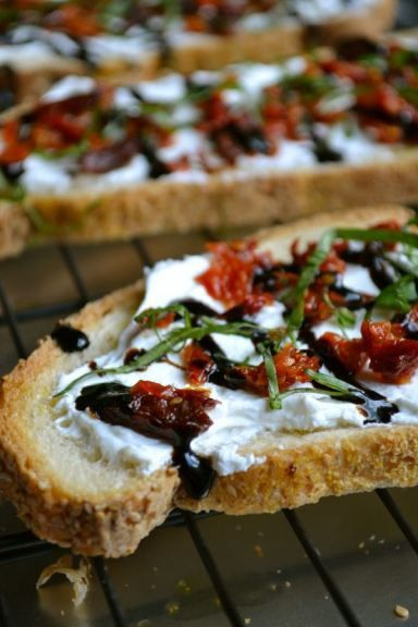 Goat Cheese and Sundried Tomato Crostini: Drizzle olive oil on bread and dust with garlic powder. Bake for about 7 minutes or until toasted and crispy.Spread goat cheese on each piece of bread, top with sun-dried tomatoes, a drizzle of balsamic glaze, and fresh basil. This appetizer is the perfect pairing with the CPK Sicilian Recipe oven-ready pizza.