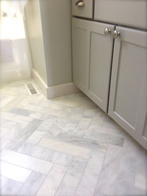 marble 3x12 herringbone floors.