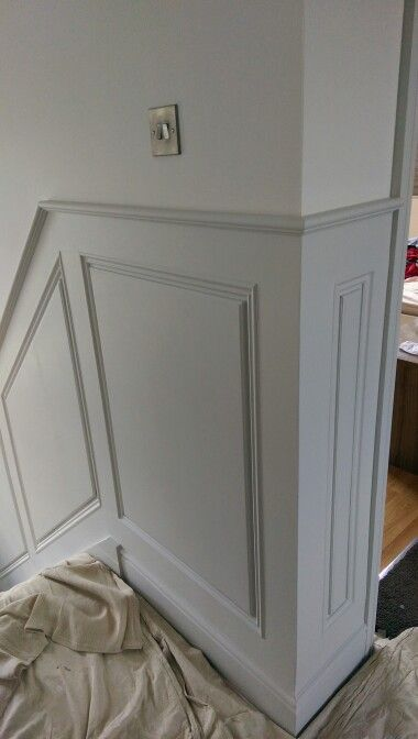The 1st coat of The Little Greene Paint Company's 161 French Gray applied to the panels with Slaked Lime 105 above.
