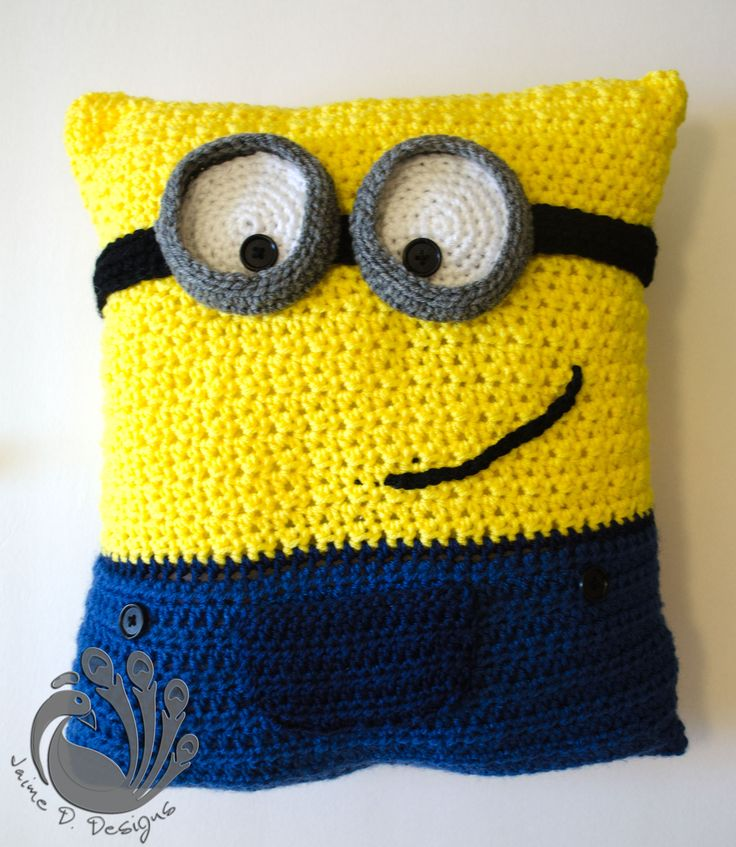 "BANANA!! How about a hand crocheted Minion pillow for your little boy or girl?   Specifications:      -12""x15""      -Made with acrylic yarn and stuffed with fiberfill       This minion pillow also has a little pocket on the front so your little one can store their favorite little treasure (..."