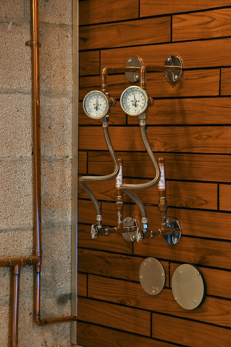 Practical SteamPunk!    Hot and cold water shutoff valves (with temperature gauges) for the bathroom next door.  A great idea nicely executed.