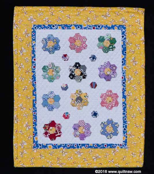 """Third prize in the 'Miniature Quilt' category at the 2015 Sydney Quilt Show. """"Mini Grandma's Flowers"""" by Jan Cardie."""