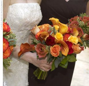 Each bridesmaid carries a bouquet of roses in a single autumn hue. The bride's bouquet combined all of the colors of those roses plus calla lilies.