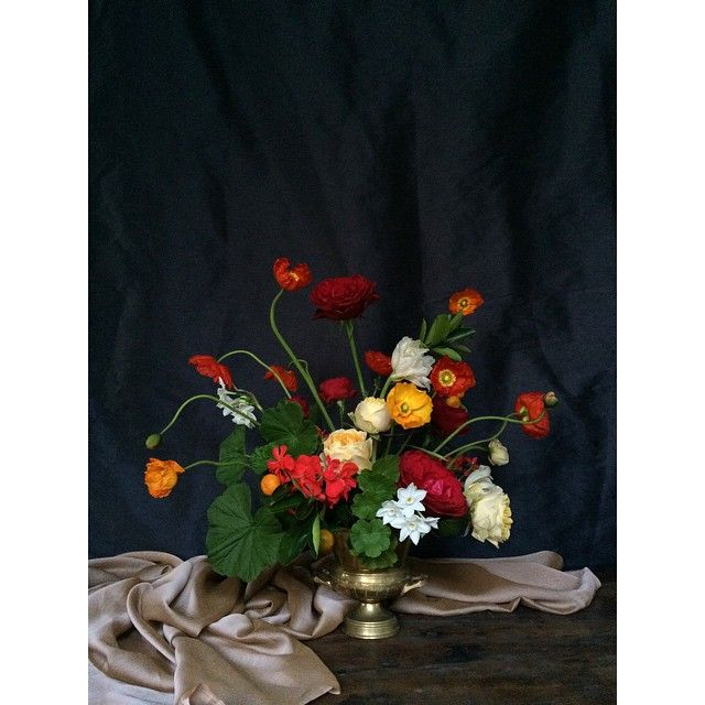 Luminous poppies augmenting the light. Flowers by Primula Floral Styling.