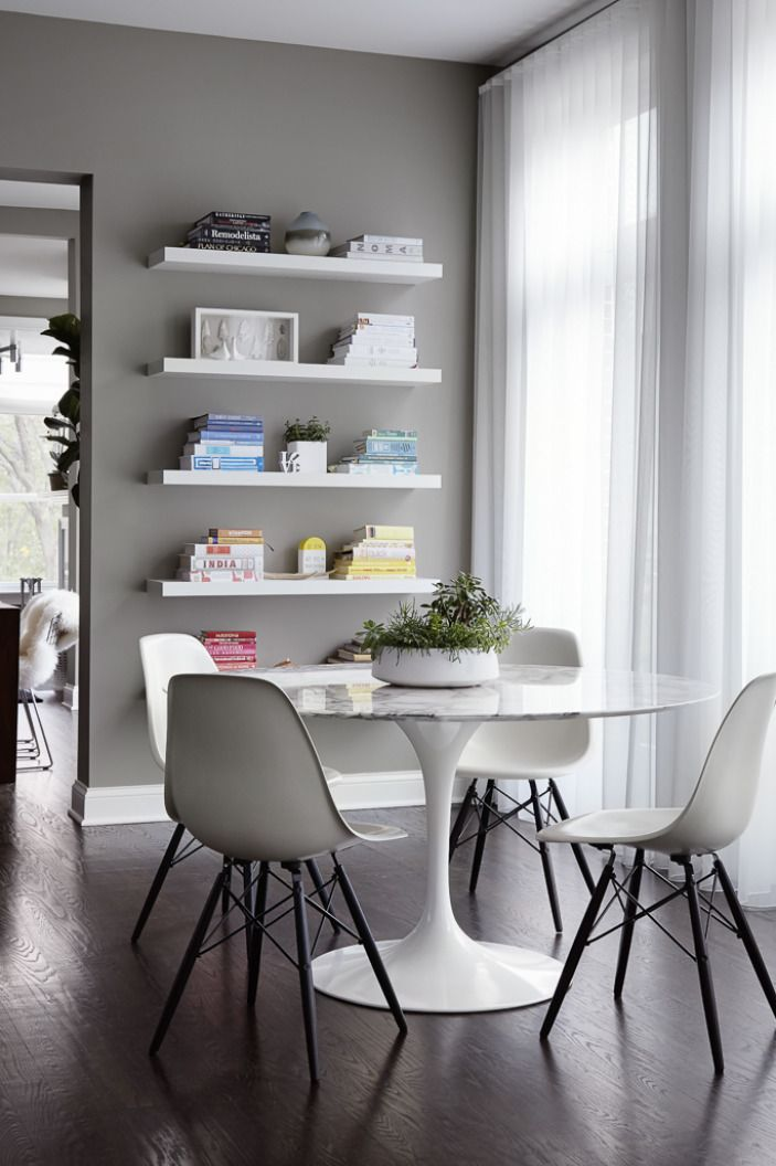 """More Eames! These are Eiffel dining chairs with a <a href=""""http://www.knoll.com/product/saarinen-dining-table-42-round"""" target=""""_blank"""">Saarinen table</a>."""