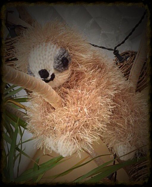 Sloth knitted in a Tinsel Wool.