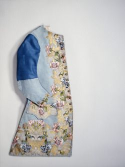 Baby blue sleeved waistcoat, 1747, England, design by Anna Maria Garthwaite, manufactured by Peter Lekeux, The Metropolitan Museum of Art.