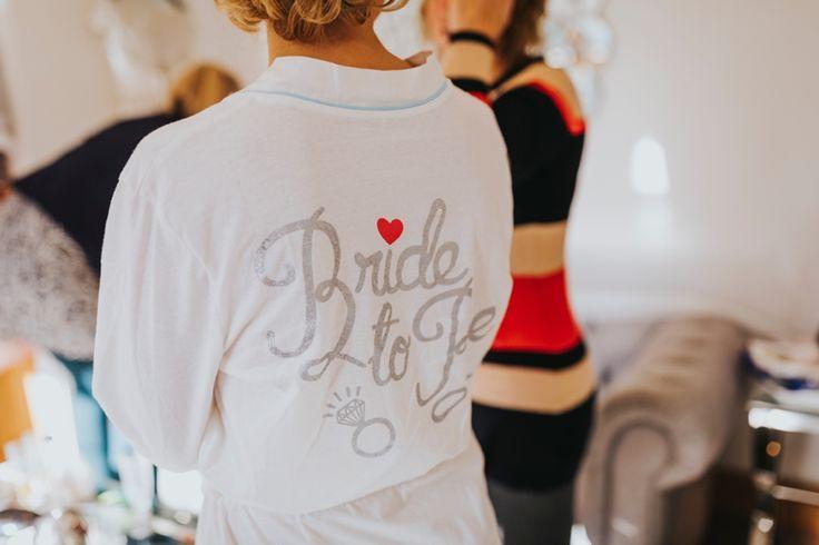 Loving this fun but practical dressing gown for bridal prep. Photo by Benjamin Stuart Photography #weddingphotography #bridetobe #dressinggown #bridalprep #weddingday #hairandmakeup