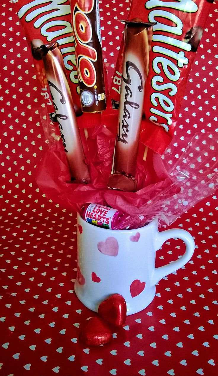 Mini Chocolate Bouquet in a #mug, perfect Valentines gift, great alternative to flowers, looks great but good enough to eat! www.facebook.com/... #valentine #hearts #lovehearts #swizzlesmatlow #chocolate #bouquet #red #silver #gift #iloveyou #marryme #sweet #candy #candycart #buffet #manchester #smallbusiness #mothersday #birthday #anniversary #thankyou #malteasers #cadbury #galaxy #rolo #lastrolo