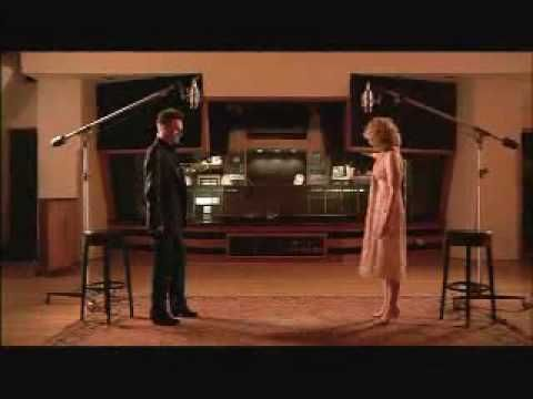 Alison Krauss & John Waite - Missing You.   Sadly, I am old enough to remember the original version.