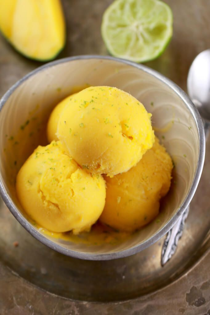 5 Minute Mango and Lime Frozen Yogurt (No Machine). The easiest Frozen Yogurt recipe you will ever make. Made with all Natural ingredients, this frozen yogurt can be made in just 5 minutes without an ice cream machine or stirring every 30 minutes.