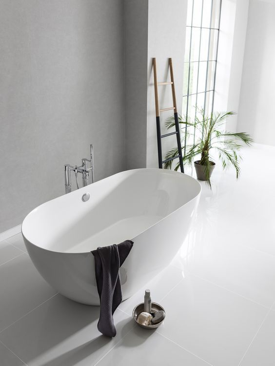 The bathroom of my dreams. Scandinavian style bathroom with green plants. The Formoso Piccolo bath from Clearwater Bathrooms