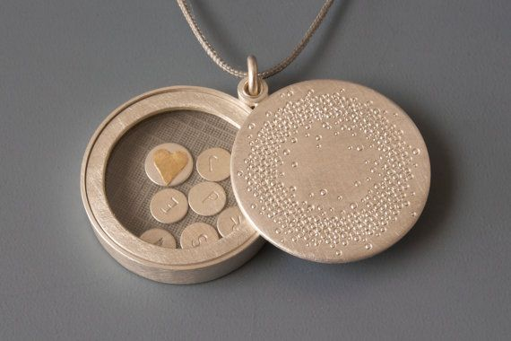 Choose a name and put it in a locket! The lid of the locket is stamped with plenty of circles in different sizes, that create a delicate and poetic