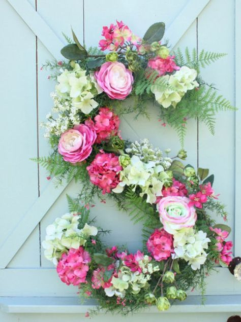 Use chicken wire, floral foam, and silk flowers to create this simply gorgeous monogram display.
