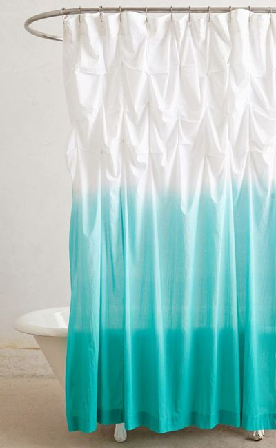 This Ocean Upward Shower Curtain instantly updates any bath with its breezy texture and stunning color. Made from cotton. $108. Buy here.