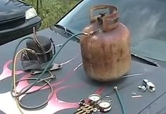 Freon Recovery System by chughes376 -- Homemade freon recovery system constructed from a surplus propane tank, refrigerator compressor, and refrigerant manifold gauge. http://www.homemadetools.net/homemade-freon-recovery-system