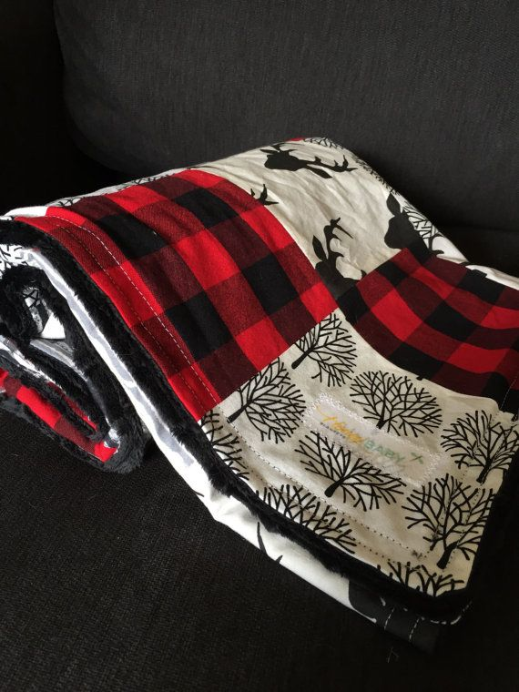 This is a custom listing made by Honey Baby Blanket. Order includes:  1. Minky Patchwork Quilt: made with organic cottons that coordinate in a modern rustic theme, this woodland lumberjack quilt is warm, stylish, and durably made. Finished with a double top stitch, backed with black dimple dot minky, and measures 34x44 2. Fitted Crib Sheet: made to fit a standard size crib mattress, this coordinating crib sheet will compliment the quilt perfectly. Sewn with French seams and secured with…
