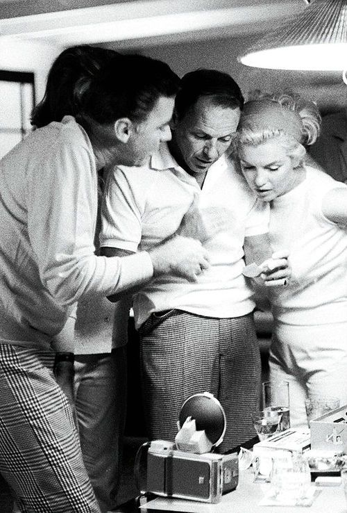 "Marilyn Monroe, Frank Sinatra & Peter Lawford, 1961. Pat Lawford, JFK's sister, standing behind Peter and was a close friend of Marilyn Monroe's. Peter also had a good relationship with Jackie and defended her when he felt the Kennedy's were too harsh towards her. Frank Sinatra referred to him as ""Brother in Lawford""."