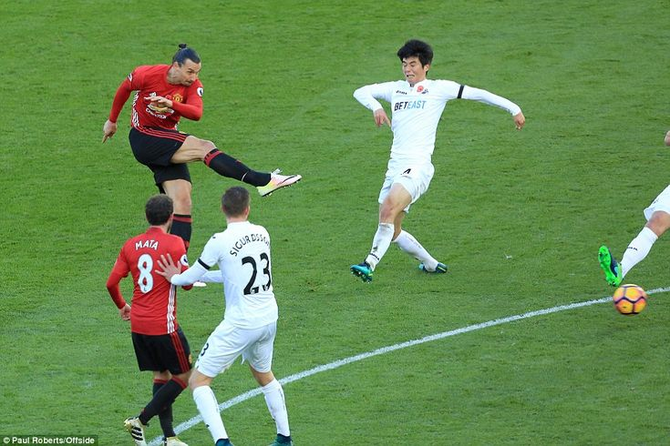 Ibrahimovic shoots at goal to score his second goal as Swansea midfielder Ki Sung-yueng fails to close the striker down