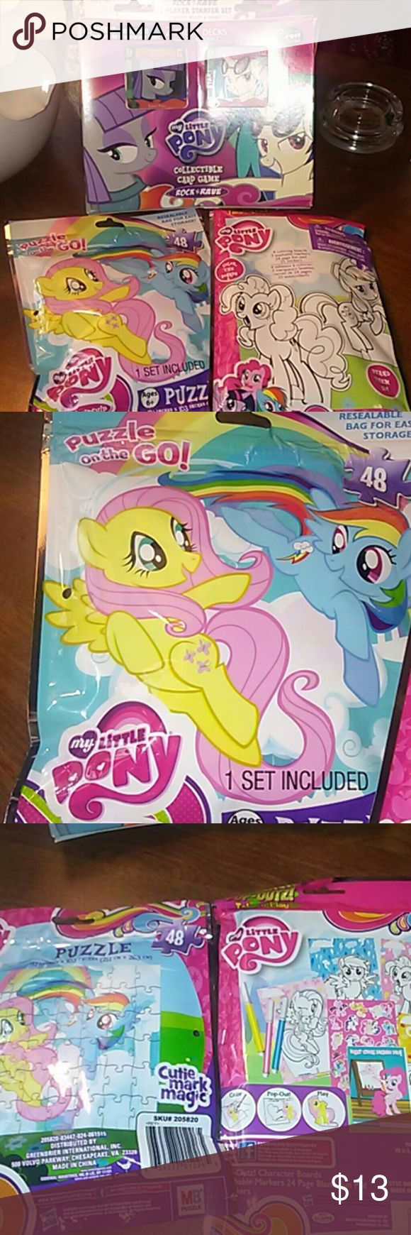 """New My Little Pony Bundle /3 items + GIFT New bundle. 3 items from My Little Pony plus including a free surprise  gift w purchase!!  """"Rock n Rave"""" Collectible card game w 2 theme deck cards and 2 exclusive foil cards!! Also a 48 piece puzzle in a resealable storage pouch. And My Little Pony Activity set which includes 4 pop-outz! Character Boards, 3 washable markers, 24 page blank fun pad and 25 stickers. Hours and oodles of fun for girls!! My Little Pony Accessories"""