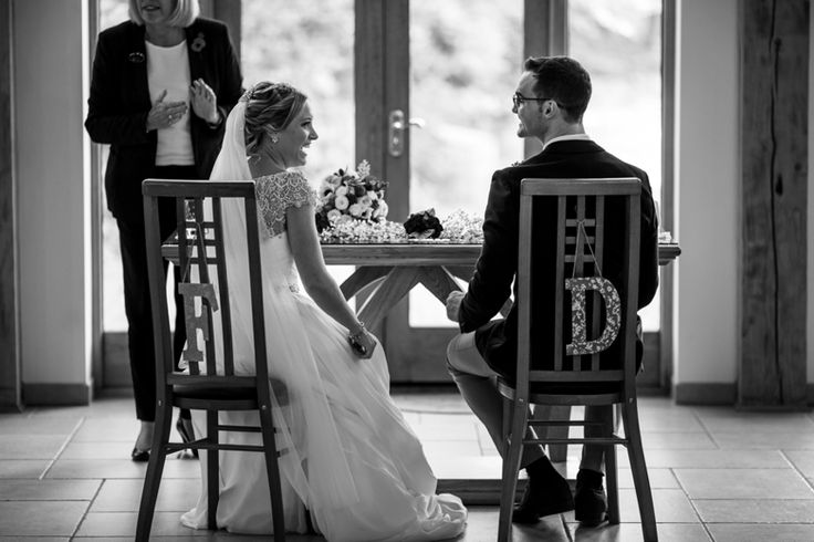 Personalised chairs for the bride and groom. Photo by Benjamin Stuart Photography #weddingphotography #weddingceremony #blackandwhite #brideandgroom #initials