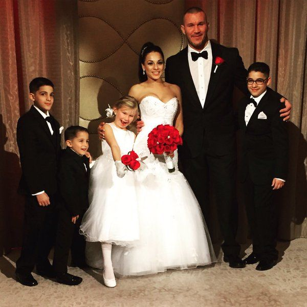 WWE Randy Orton married Kim Marie in Nov 2015. With them are Alanna (Randy's daughter) and Kim's 3 boys. Lovely family.