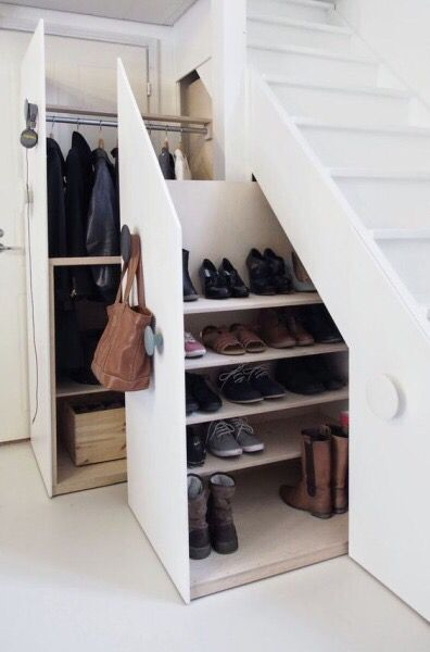 Concealed Under the Stairs Coat and Shoe Drawers on wheels. Terrific idea!