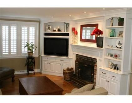 Option: instead of TV above fire place, rebuild corner shelves.