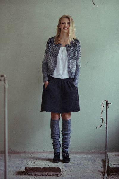 Striped grey raglan cardigan with 7 button on front, round neck and long sleeves. Garment is knitted from wool on manual knitting machine. Seams are sewn with sewing machineand hand crafted to...