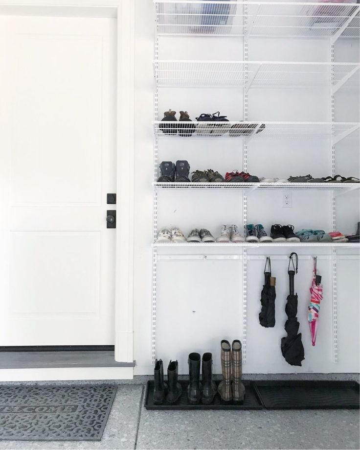 This Is The Most Beautiful Garage Light Bright New Shelving Wide Open And Totally Organized Organ Garage Shoe Storage Mud Room Garage Garage Organization
