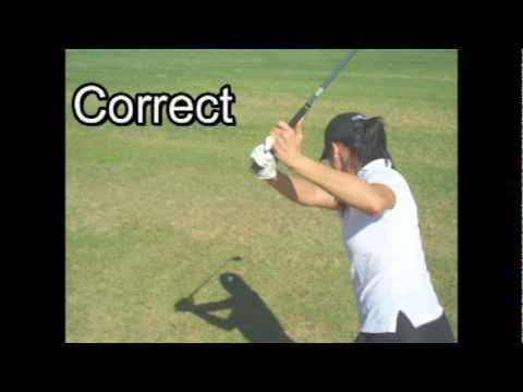 A very simple, yet highly effective golf drill to help get your swing center back in balance. Golf pro Tom Ward has one of his women students demonstrating the exercise.