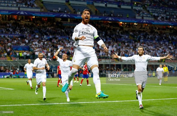 Sergio Ramos of Real Madrid jumps in the air in celebration after scoiring the opening goal during the UEFA Champions League Final match between Real Madrid and Club Atletico de Madrid at Stadio Giuseppe Meazza on May 28, 2016 in Milan, Italy.