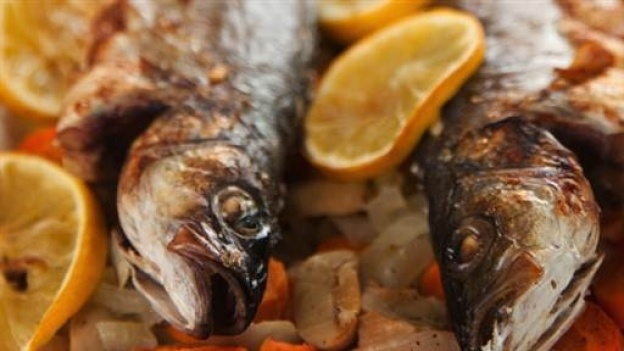 Fresh and tasty sea bass with orange reduction and served with new potatoes and mange tout - part of Lorraine's Bikini and Beauty Diet .