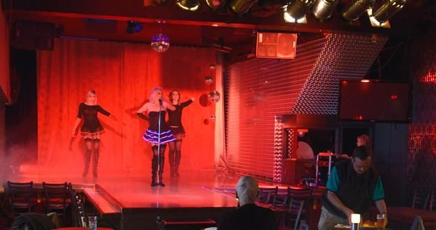 """""""One racy new tour aims to shine a light on the not-too-distant past by taking visitors behind the curtain at downtown's infamous Penthouse strip club."""" 