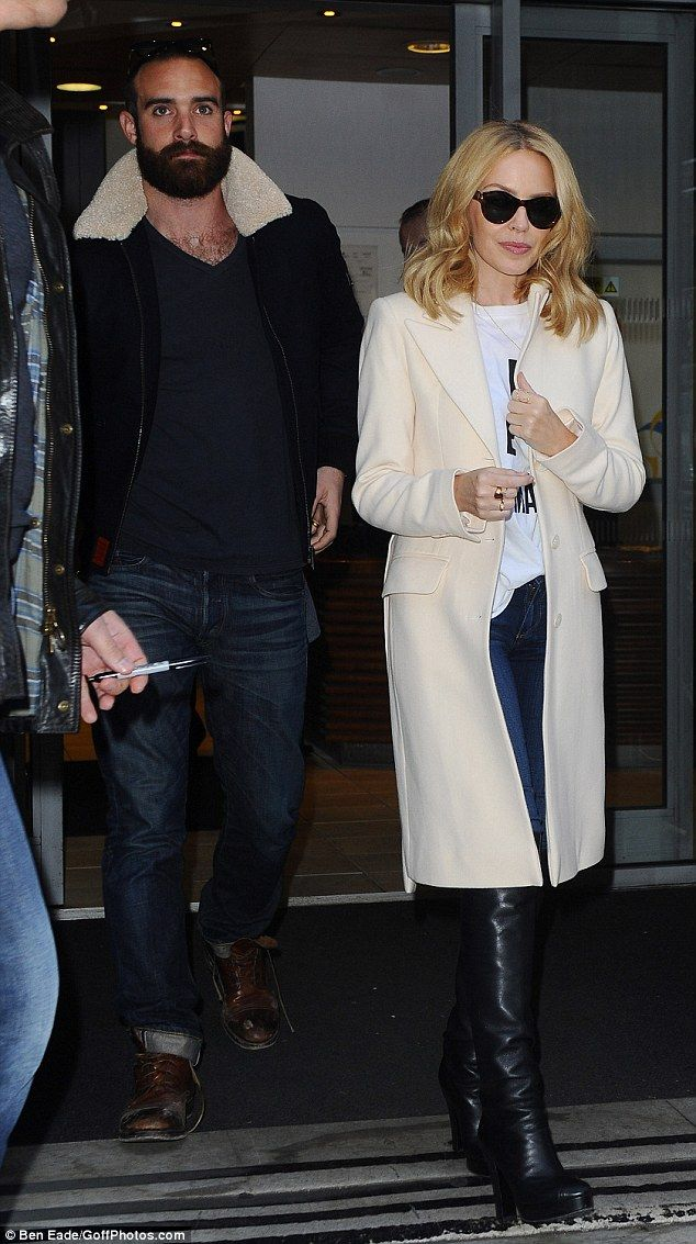 Best supporting beau: Kylie Minogue was accompanied by her boyfriend Joshua Sasse as she p...