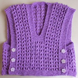 Melika Lacy Baby Vest | AllFreeKnitting.com I might consider picking up knitting needles for this one.