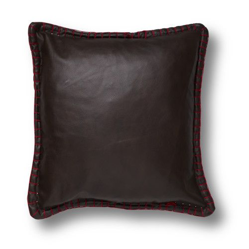 This gorgeous throw pillow is sure to add drama through texture to your seated areas. The leather pillow is accented by bright red whip stitching across the sides.