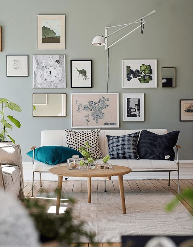 modern living room with olive gray walls, olive green, sage green, army green, gray-green, green-gray, grunge green, neutral green, modern living room, frame wall, blue accent pillows, sherwin williams acier