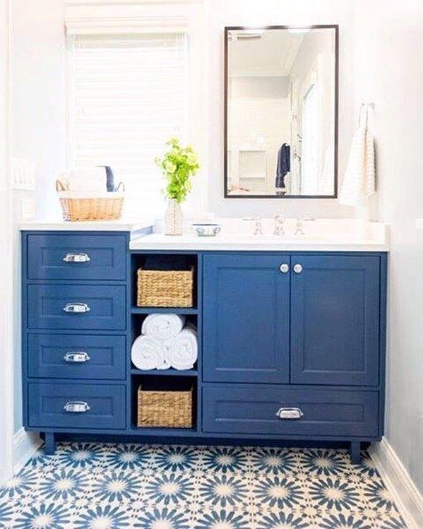 """Bringing a whole new meaning to """"Monday Blues."""" #repost @fosterhilldesign    We love the challenge of making a small space work hard. Case in point  this Evanston bath. We added a pocket door to eliminate the door swing and designed a custom vanity for plenty of storage. We maintained the same footprint but the space now feels twice as large. Stylish @AnnSacks cement tiles complete the look. #bath #designinspo #interiordesign  thanks to @mushroomstew"""