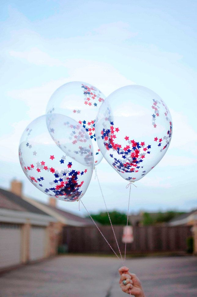 For last minute decorating, try these confetti-filled balloons. Super easy (and super affordable!) all you'll need are a few clear balloons and star-shaped confetti. The kids (and even adults) will love 'em. Plus, once you've master these Americana inspired balloons, you'll be able to use this idea for any holiday — like the upcoming Olympics, for example.