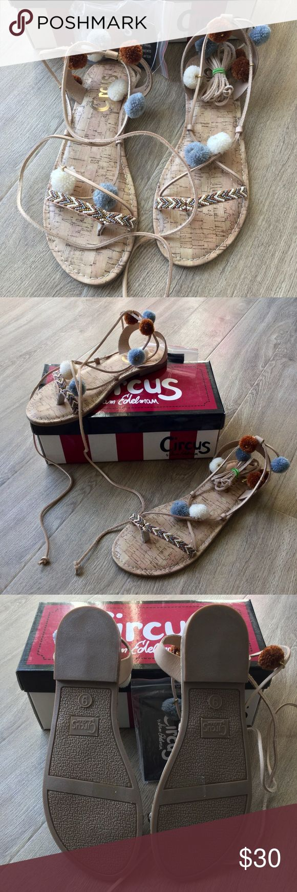"""NWB Circus by Sam Edelman Valencia flat sandal 9 The perfect go-to sandal for every casual weekend or brunch outing.  * New in box * Thong sandal * Ghillie lace-up with wrap around ankle tie * Pom accents along ties (extra poms included in box) * Brown, white, and blue poms * Chevron patterned beading details at toe strap * Faux leather upper * Synthetic sole * Sole: 10 1/2"""" approx.  * Bundle discount * No trades * Smoke free, pet friendly home Circus by Sam Edelman Shoes Sandals"""