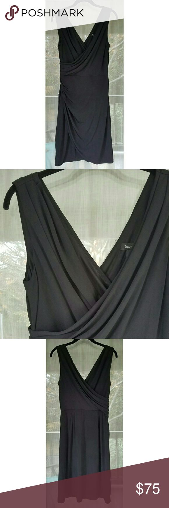 Wrap v neck black dress Beautiful dress with wrap-like fabric lay. New with tags! Shell 95% polyester, 5% spandex. Lining 100% polyester. Side zip. White House Black Market Dresses