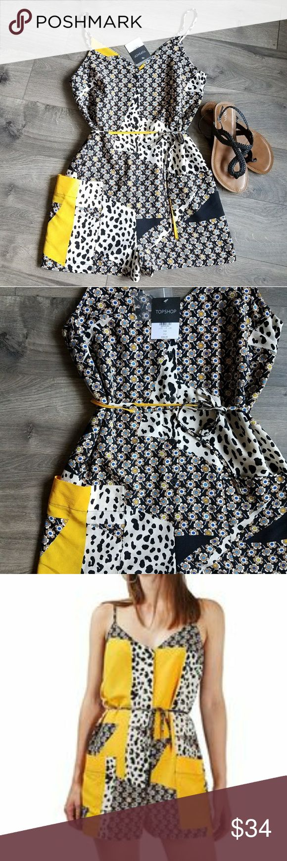 ⬇PRICE DROP⬇ TOPSHOP animal and daisy print romper New with tags TOPSHOP animal and daisy print romper.   Super cute and stylish. Featuring front buttons and belt. Topshop Shorts