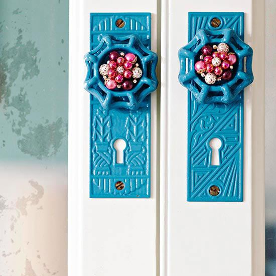 Beautiful Baubles the handles on the old china hutch were made using doorknob backplates and water spigot handles. Vintage clip-on earrings were detached from the clip and secured with metal glue to top off the look.