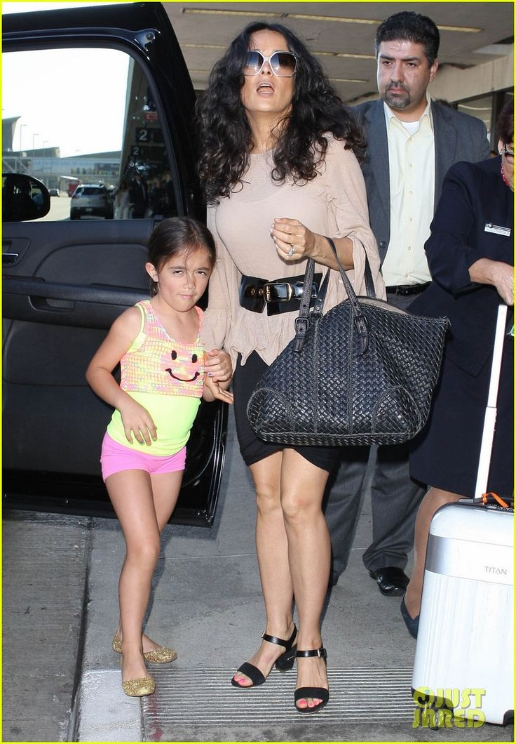 Salma Hayek departs a flight at LAX Airport with her daughter Valentiina on July 30, 2013